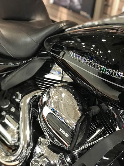 A close-up of a motorcycle's shiny silver engine.